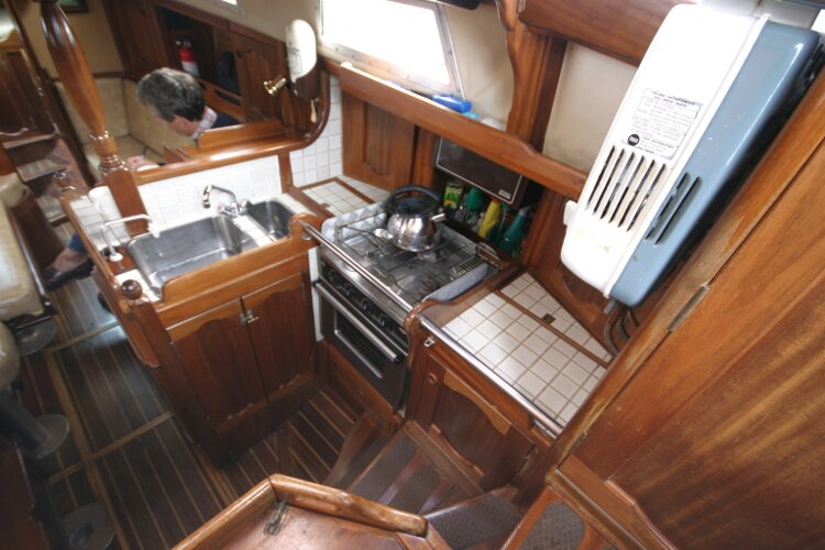 Bruce Roberts 34 Sailing Yachtfor sale Looking down the Companionway Steps. - View of galley.