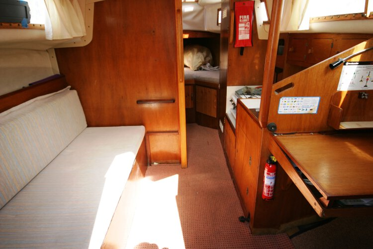 Colvic 26for sale The saloon - Looking at the port side settee  with the galley and chart table to starboard