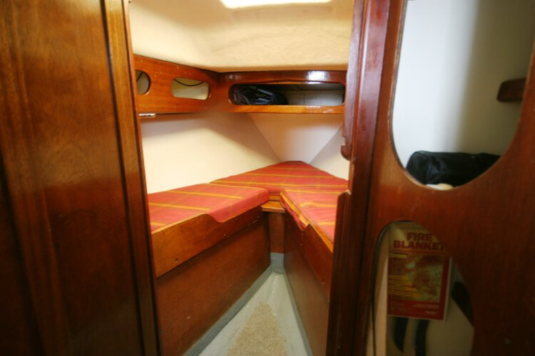 Morgan Giles for sale The fore cabin - With two berths, the heads compartment is located to port and the hanging locker to starboard