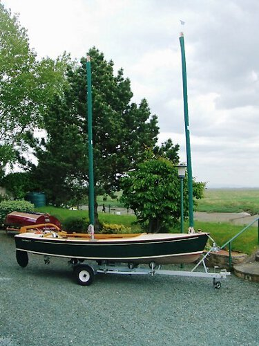 Wooden Classic Core Sound 17for sale On her trailer - Note the sail socks protecting the twin Goacher sails.