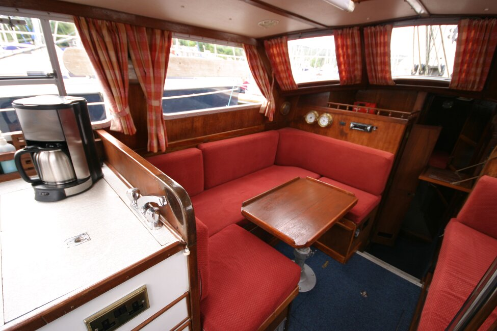 Trident Voyager 35for sale Port side saloon seating and dining area -