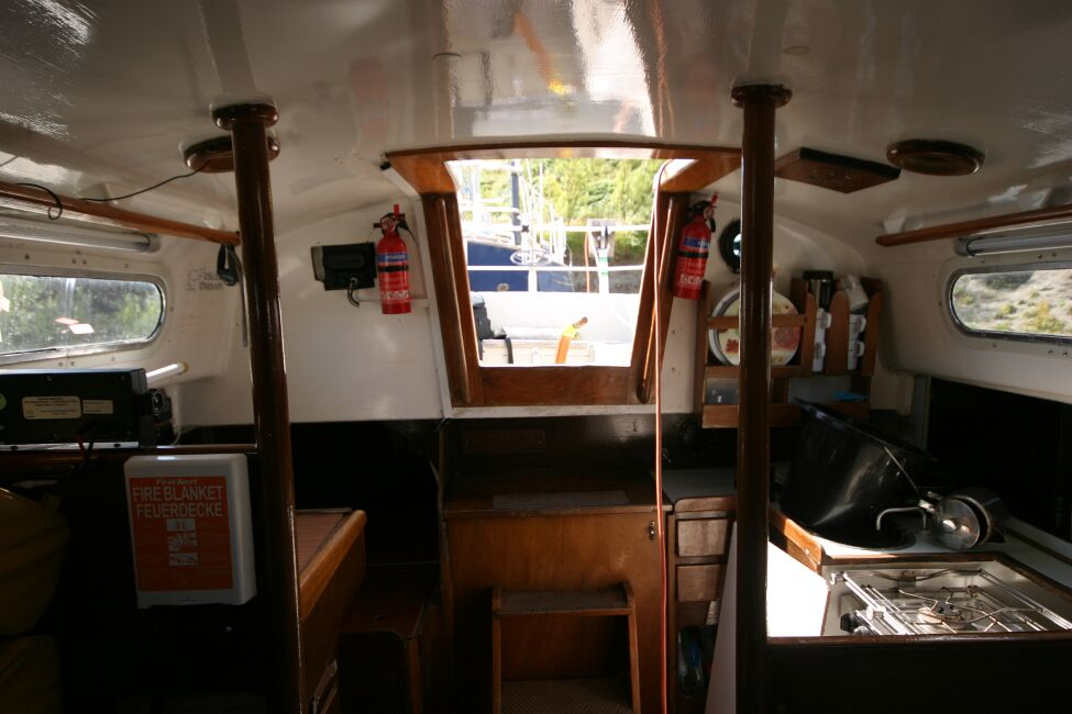 Contessa 32for sale View from forward in the saloon, aft to companionway - Quarter berth on starboard side