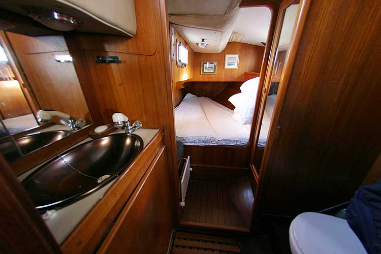 Jeanneau Trinidad 48 Ketchfor sale Port aft cabin - with heads in the foreground