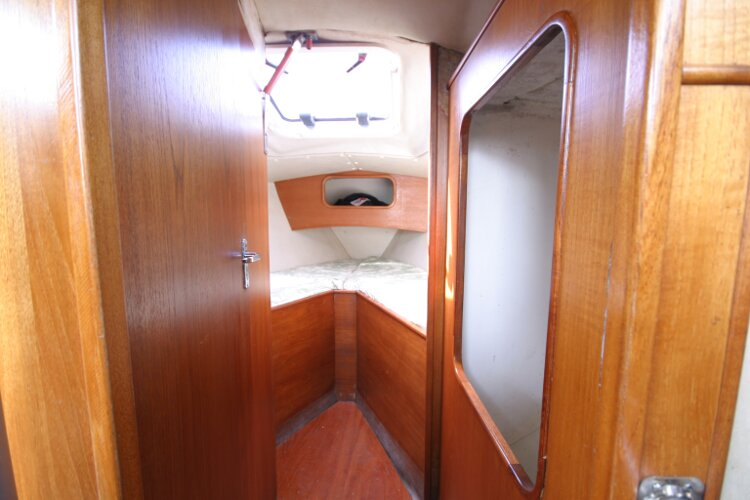Colvic UFO 27for sale Looking into Forward cabin - Hanging locker to the right, heads compartment to the left.
